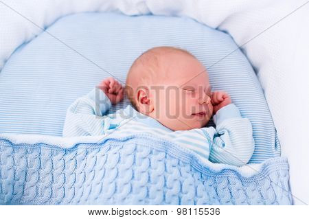 Newborn Baby Boy In White Bassinet