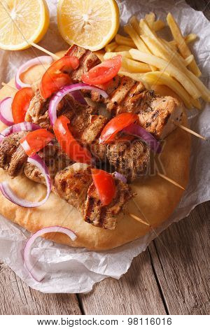 Greek Souvlaki Kebab With Pita And Vegetables Close-up Vertical