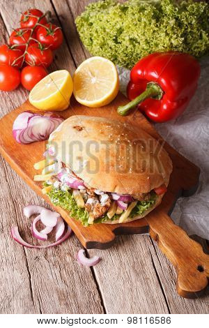 Doner Kebab In Pita Bread Closeup. Vertical Top View