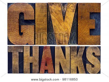 give thanks - Thanksgiving concept - isolated word abstract act in letterpress wood type with ink patina