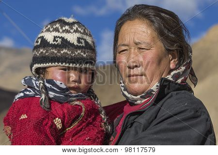 Local Woman With A Child On The Street In Leh, Ladakh, India