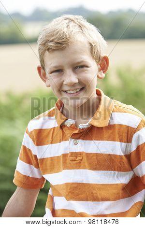 Outdoor Head And Shoulder Portrait Of Boy