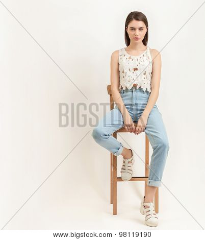 Full length portrait of young foxy beautiful brunette woman posing for model tests against white bac