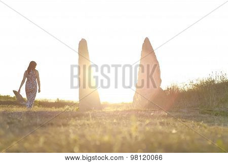 Silhouette of woman at sunset light rays