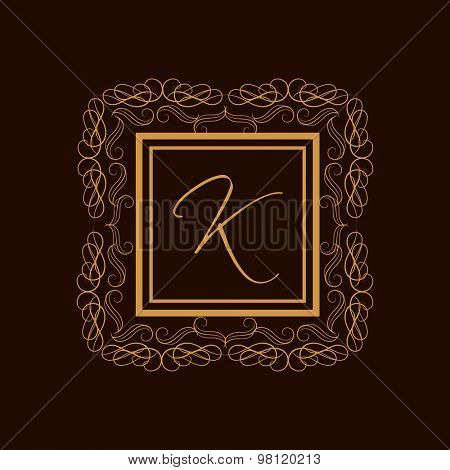 Creative premium monogram design with stylish English Alphabet K in beautiful floral frame on brown background.