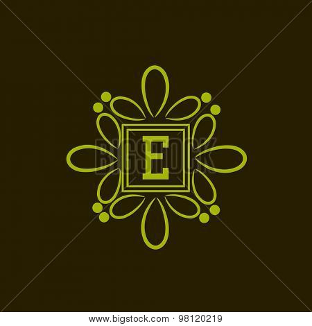 Stylish monogram design with green floral frame and English Alphabet E.