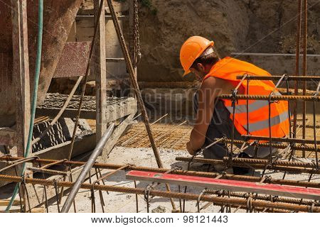 Pouring the concrete foundation of the building site shopping center