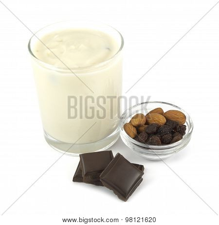 Yogurt desert with chocolate, almond and raisins isolated on white background