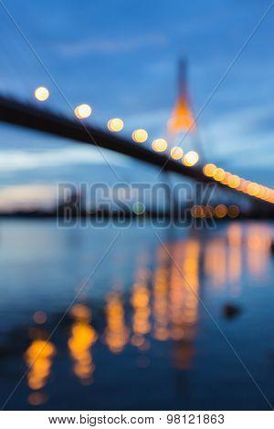 Blurred bokeh city light of suspension bridge
