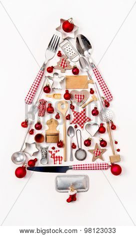 Christmas tree of old and antique miniatures in red, silver and white colors for decoration.