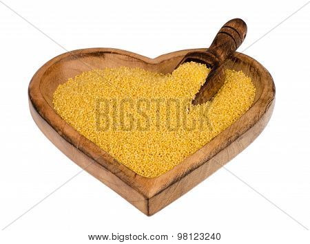 Millet on the wooden boil with the spoon isolated.