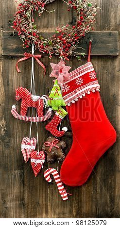 Christmas Stocking And Handmade Toys Hanging. Vintage Decoration