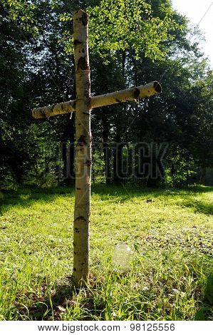 Wooden Cross On A Rural Cemetery
