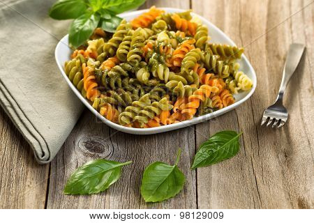 Homemade Pesto With Pasta On Rustic Wooden Table