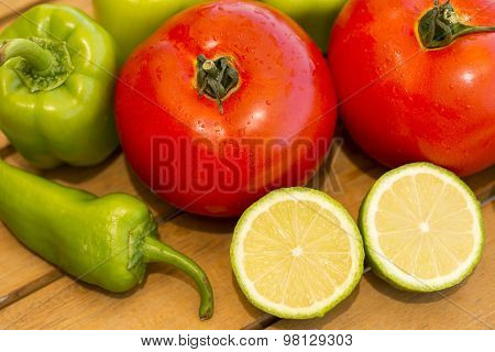 Wet Tomatoes, Green Bell Pepper, Green Pepper And Sliced Half A Lemon Pieces