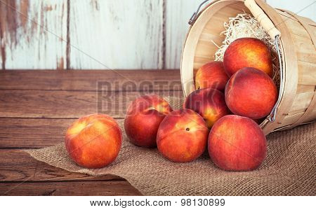 Fresh Peach Fruits In A Basket, Rustic Wooden Background