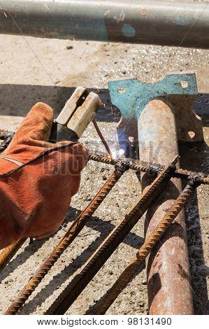 Welding. Welding metal rods into the net.