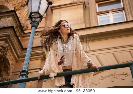 Bohemian Girl With Sunglasses Near Old Town Streetlig