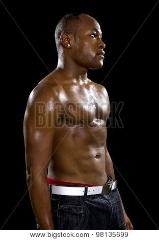 Muscular Black Man on a Black Background