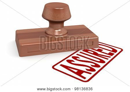 Wooden Stamp Assured With Red Text