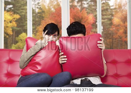 Couple Watching Horror Movie At Tv