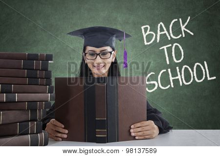 Girl With Mortarboard And Book Back To School
