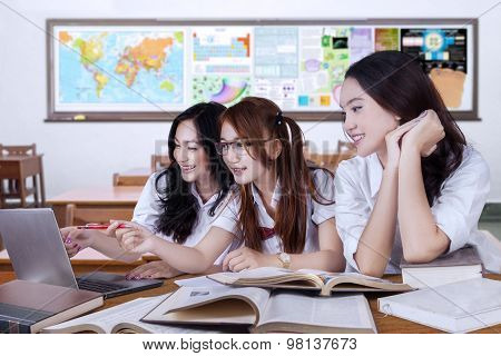 Group Of Female Learners Studying In The Class