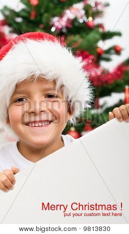 Happy Boy With Christmas Hat And Blank Sign