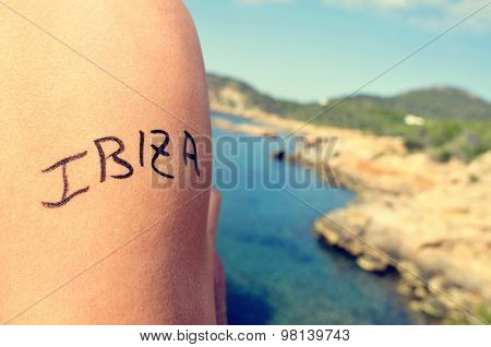 closeup of the arm of a young man with the word Ibiza written in it, in the southern coast of Ibiza Island, in Spain, in the Mediterranean sea