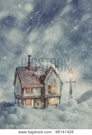 Winter cottage in snow