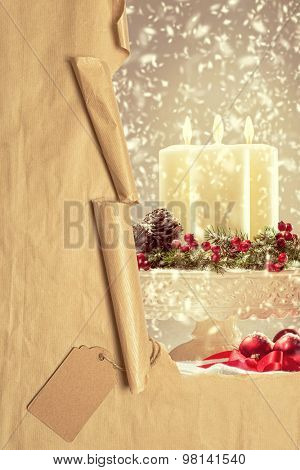 Torn paper parcel revealing Christmas candles