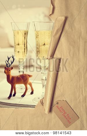 Torn paper with tag revealing Christmas champagne