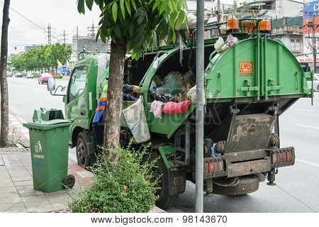 Ashman Loads Garbage Into A Truck