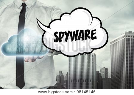 Spyware text on cloud computing theme with businessman