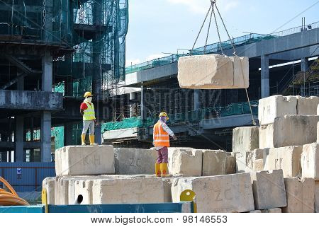 Construction workers stacking the maintain load test block at the construction site Construction wor
