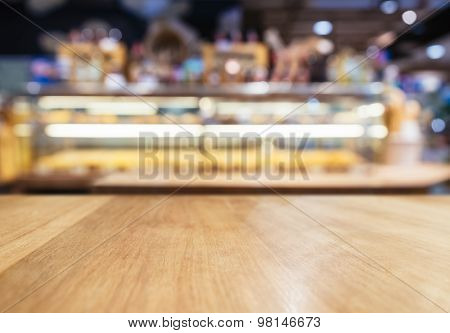 Table Top Counter With Blurred Bread Display Shelf Bakery Shop Background