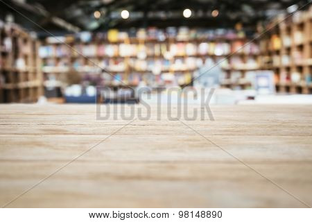 Table Top Counter With Blurred Bookshelf Bookstore Background