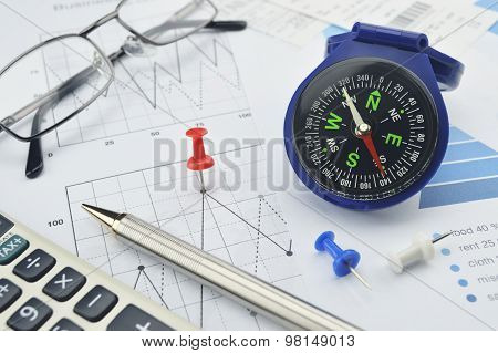 Blue Compass, Calculator, Pen And Glasses On Graph Paper, Success Concept