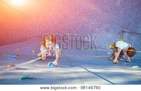 Little girl in  rock climbing gym