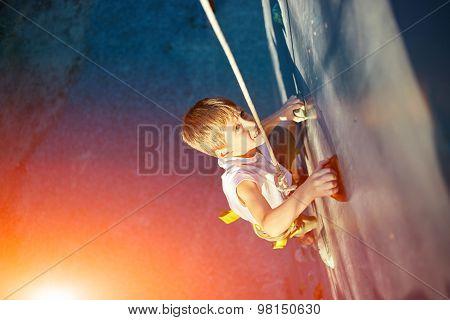 Little boy in  rock climbing gym