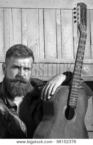 Unshaven Man With Guitar