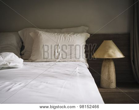 Bed Sheet Matress And Pillows In Bedroom With Lamp Natural Style Home Interior Decoration