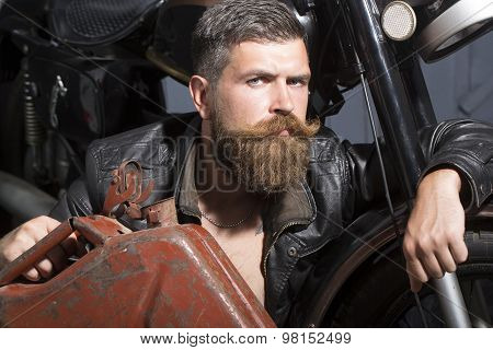 Attractive Man With Fuel Can