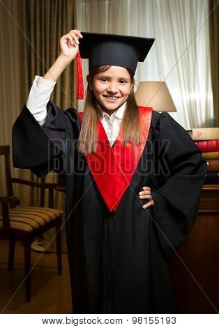 Girl In Graduation Cap And Gown Posing At Classic Interior