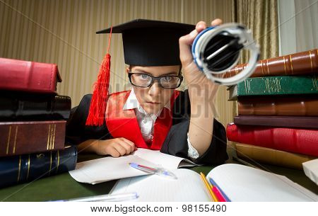 Girl In Graduation Cap Putting Stamp On Document