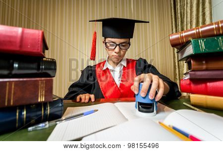 Girl In Graduation Cap Playing In Lawyer And Putting Stamp On Document