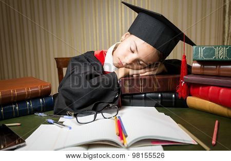 Sleeping Girl In Graduation Cap Lying On Table Full Of Book
