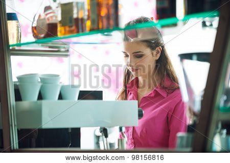 Barista Making Coffee With A Coffee Machine