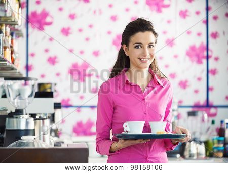 Young Smiling Waitress Serving Coffee At The Bar
