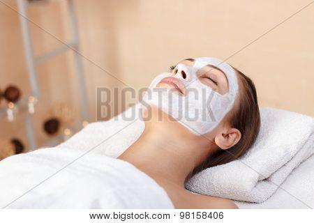 Attractive woman having mask in spa salon